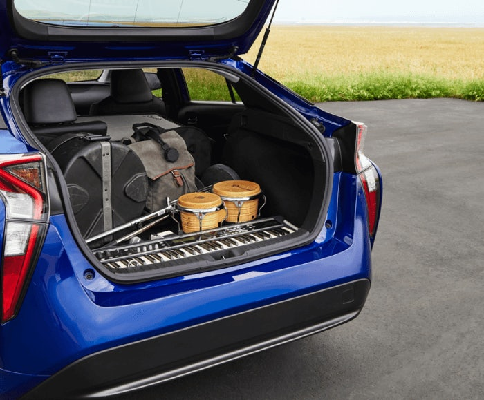 Angular view of the cargo space of the Prius Four in blue. The Prius Four cargo space comfortably holds a number of volume of musical instruments and cases.