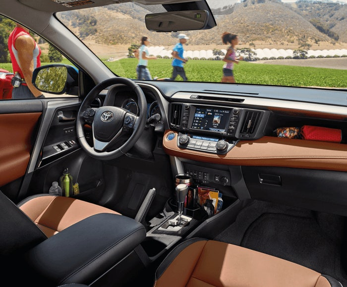 Interior view of the RAV4 Limited Hybrid with Cinnamon Softex interior trim.