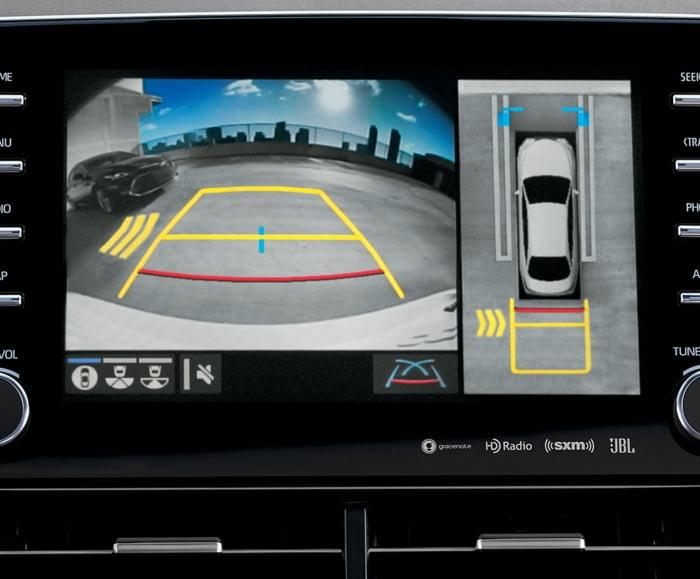 Interior view of 2019 Avalon's dashboard with Rear Cross Traffic Alert with Blind Spot Monitor on screen.