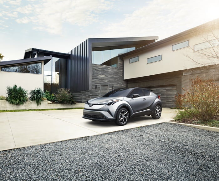Landscape view of  the 2019 C-HR Limited in Silver Knockout Metallic parked in a family home.