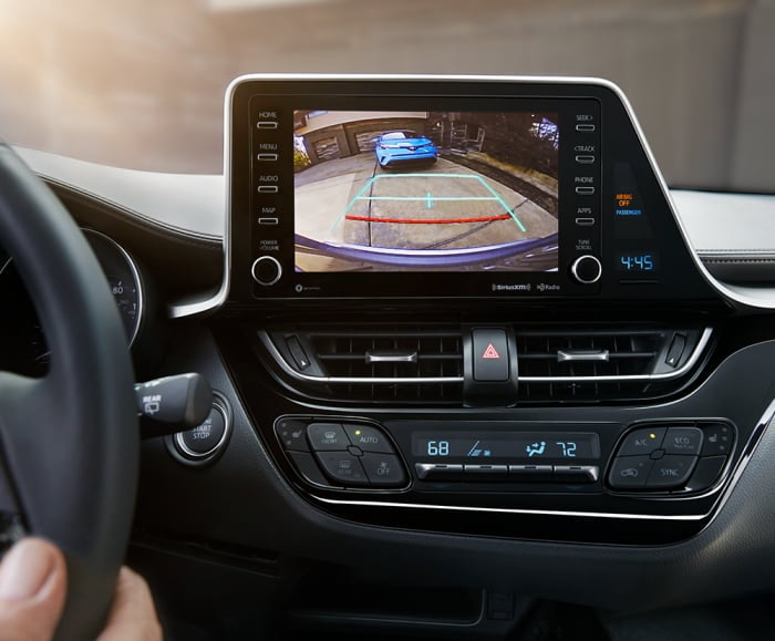 Front-facing image of the 2019 C-HR Limited infotainment system with black interior fabric.