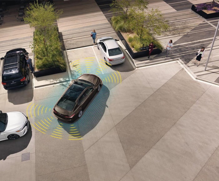 Overhead Shot of Camry pulling into parking spot. Overlay of blue and yellow sonar lines.