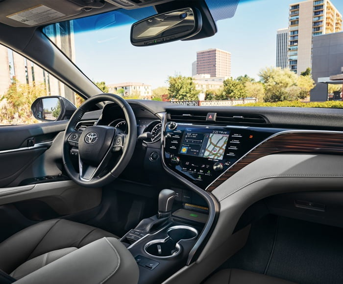 Interior view of steering wheel and IP dash of 2019 Camry in black.